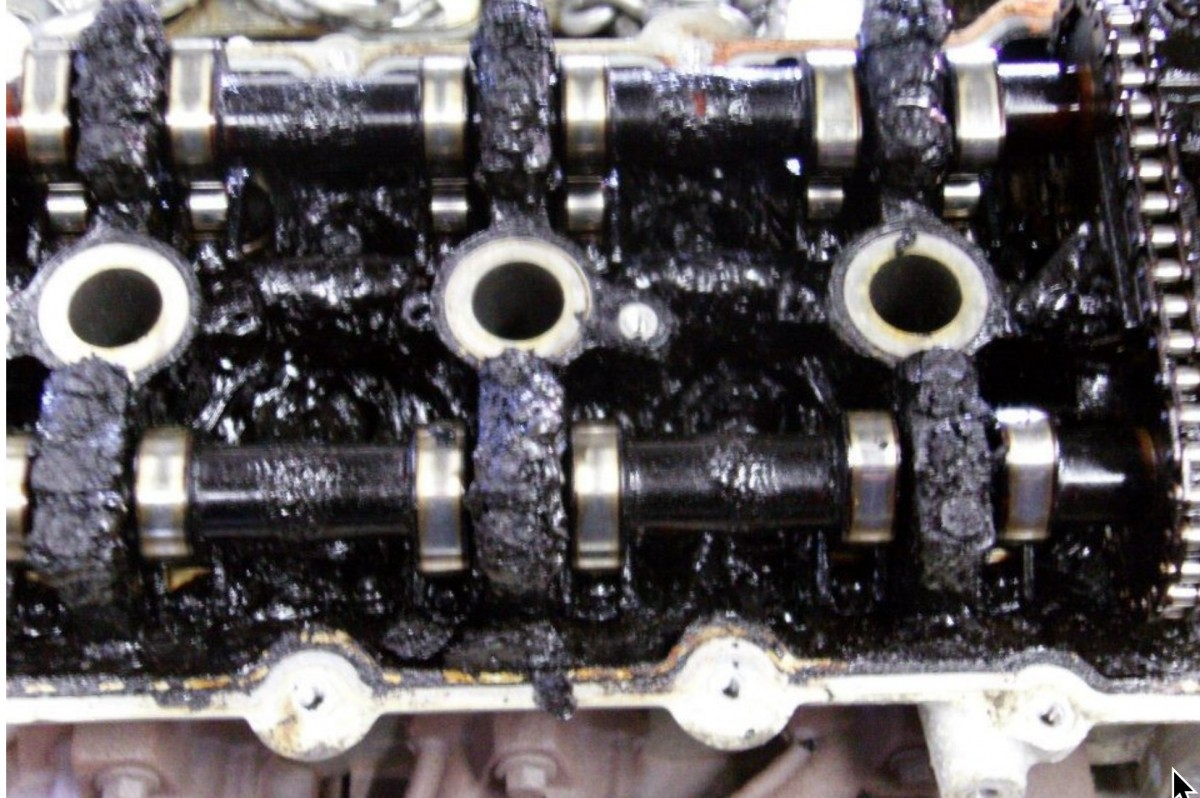 Oil gunked up on an engine.